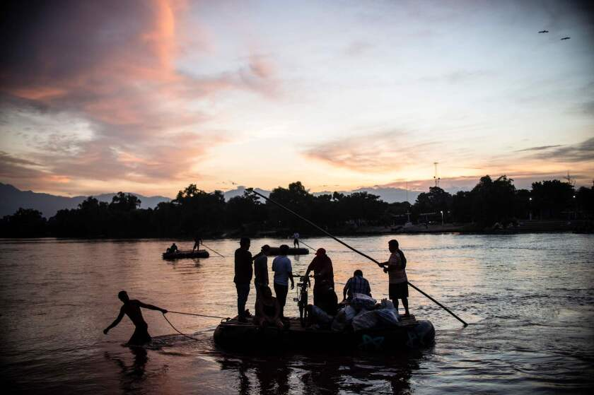 Migrants and residents use a makeshift raft to cross the Suchiate river between Mexico and Guatemala, at Ciudad Hidalgo, Mexico.