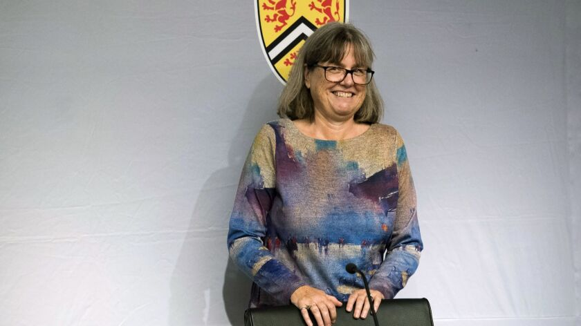 Noble Prize winner Donna Strickland smiles as she receives a standing ovation at the University of Waterloo in Canada. She is the third woman to win the physics prize.