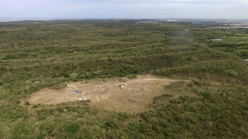 The wooded area known as Colinas de Santa Fe, on the outskirts of Veracruz, where authorities work to find the remains of people buried in mass graves is seen from the air on March 15.