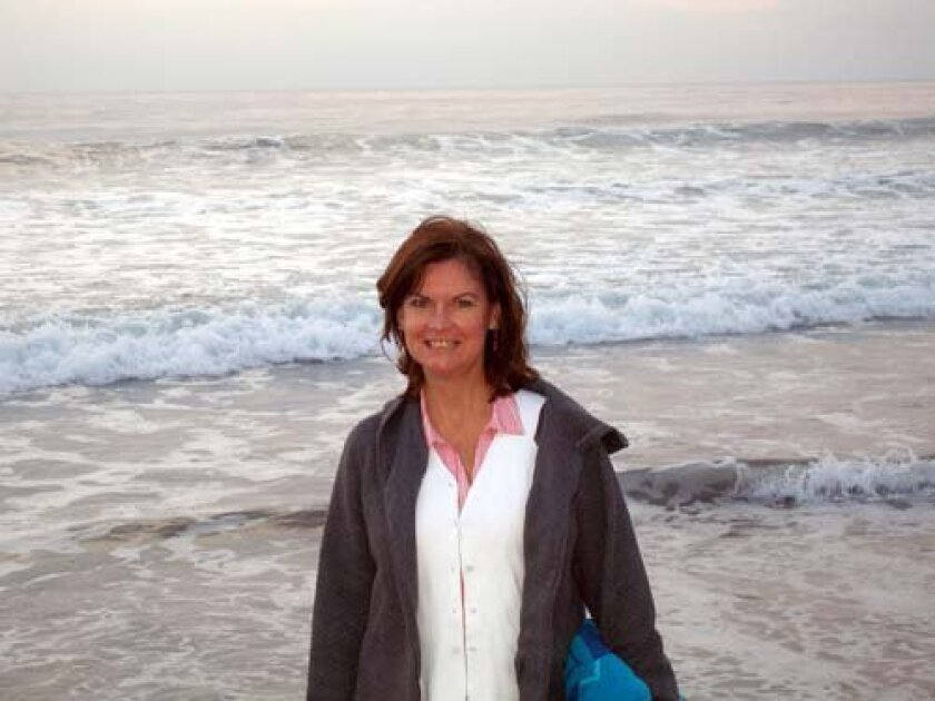 Susan DeMaggio relaxes at the beach.
