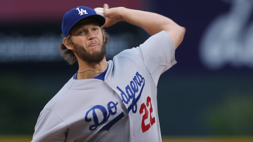 Dodgers starter Clayton Kershaw delivers a pitch during the first inning of the Dodgers' 6-1 win over the Colorado Rockies in a rain-shortened game Sunday.