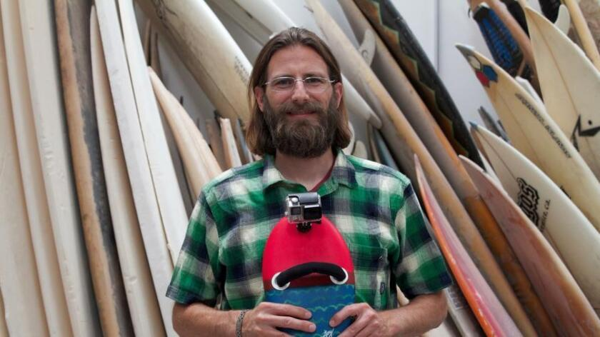 Ed Lewis with his Enjoy Handplanes made of old boards. (Ken Lewis)