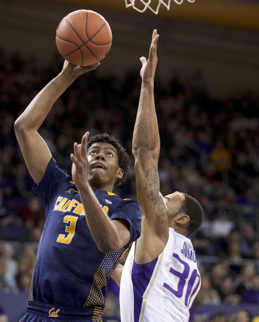 California's Tyrone Wallace (3) shoots over Washington's Desmond Simmons (30) during the first half of an NCAA college basketball game Saturday, Feb. 15, 2014, in Seattle. (AP Photo/Stephen Brashear)
