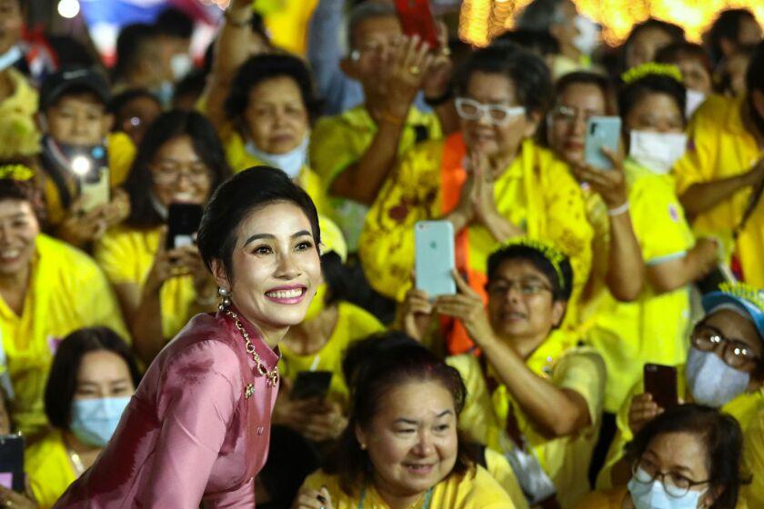 Thailand's royal noble consort, Sineenat Bilaskalayani, greets supporters Nov. 1 outside Bangkok's Grand Palace.