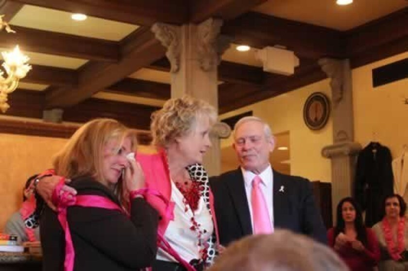 Dani Grady (center), a Susan G. Komen survivor of the year and SK Institute board member, gives an emotional thank you to Lynn Krant and Stephen Krant.