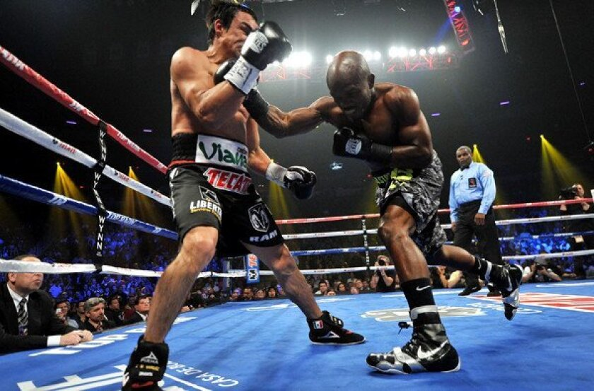 Timothy Bradley lands a right hand against Juan Manuel Marquez during their bout on Saturday night in Las Vegas.