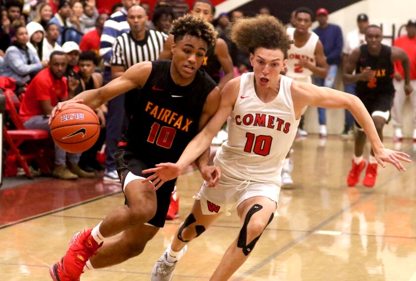 Fairfax guard Keith Dinwiddie drives against Westchester's T.J. Wainwright during their Western League game on Dec. 13, 2019.