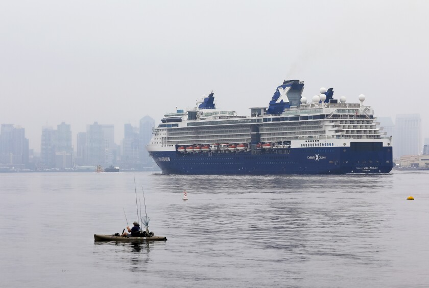 Passing a pair of kayaking fishermen, the cruise ship Celebrity Millennium pulls into San Diego Bay. The ship was returning to the B Street Pier on Friday, May 1, 2020, and before that was anchored just off the coast of San Diego.