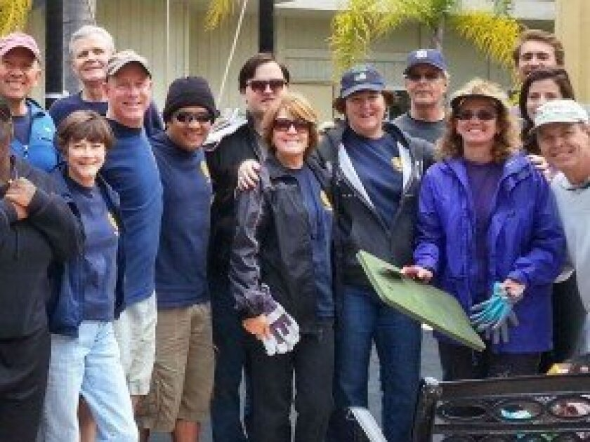 """Many of the Del Mar-Solana Beach Rotarians and friends who worked at the Take Wing transitional housing facility on """"Rotarians at Work Day,"""" April 26. Upper far left corner is Ron Plotts, the Take Wing Program manager for San Diego Youth Services."""