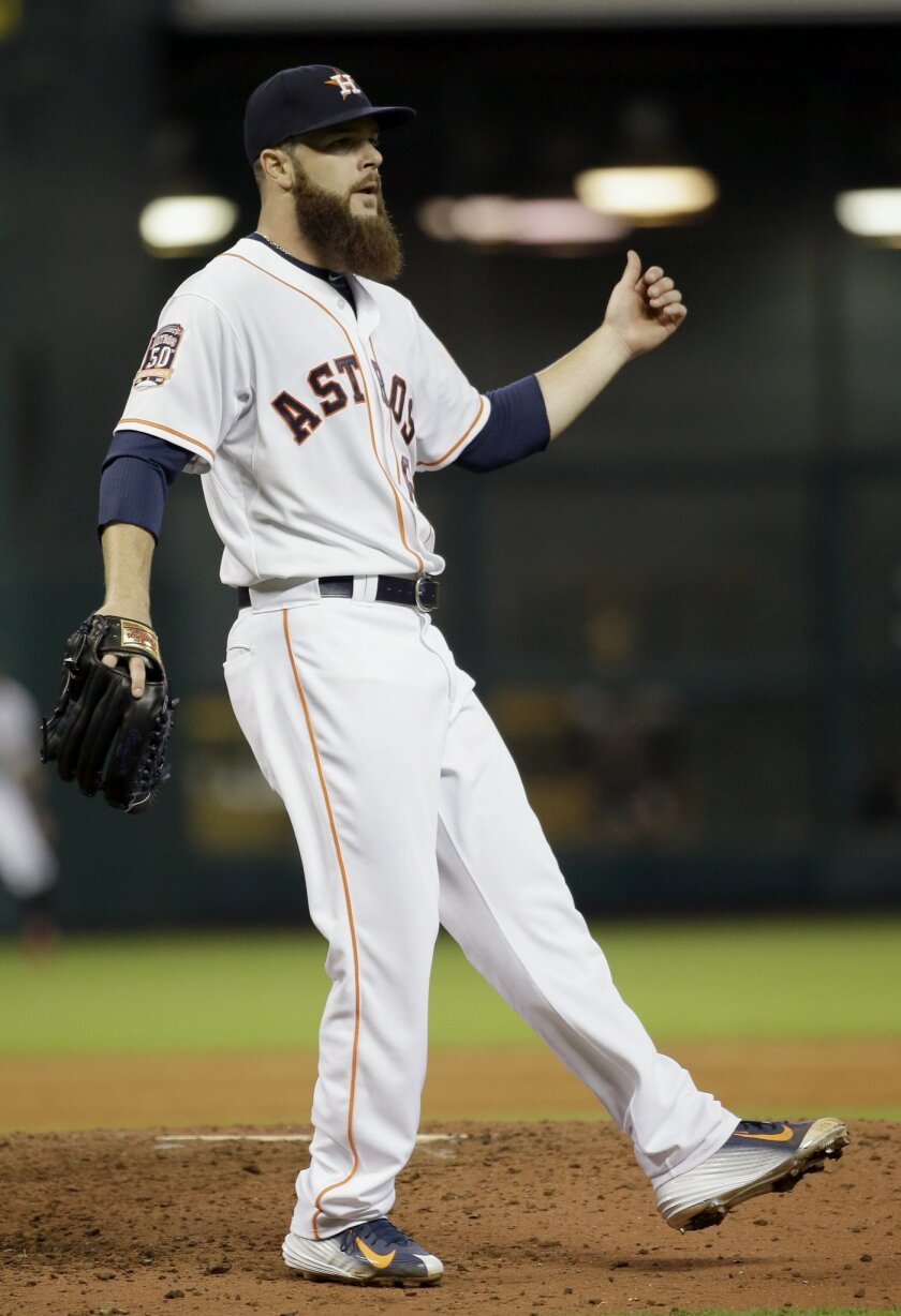 Houston Astros starting pitcher Dallas Keuchel reacts after striking out Chicago White Sox's Melky Cabrera in the ninth inning to end a baseball game Saturday, May 30, 2015, in Houston. The Astros won 3-0. (AP Photo/David J. Phillip)