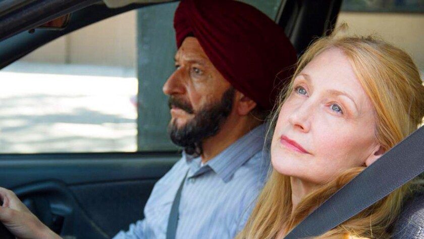 "Patricia Clarkson, right, and Ben Kingsley in a scene from the movie ""Learning to Drive."""