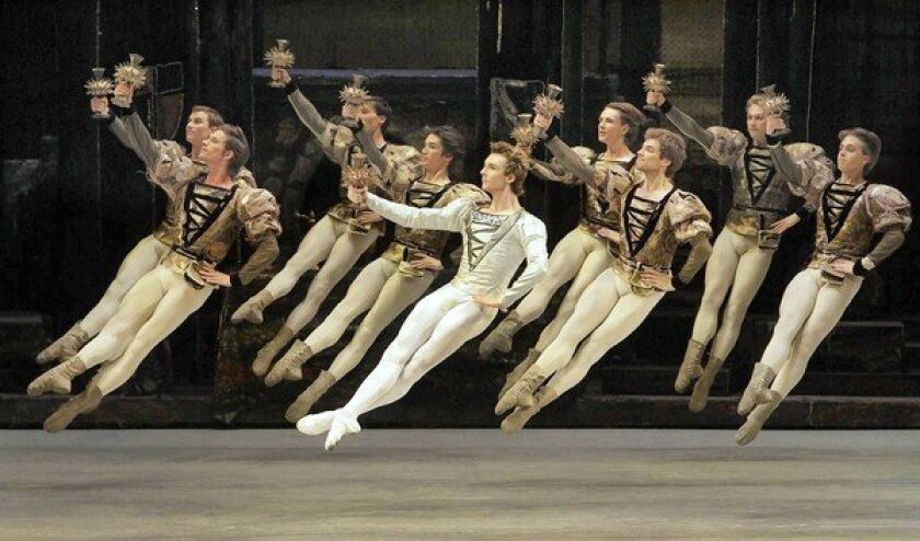 "The Bolshoi Ballet's Semyon Chudin (Prince Siegfried) with the ensemble in ""Swan Lake."""