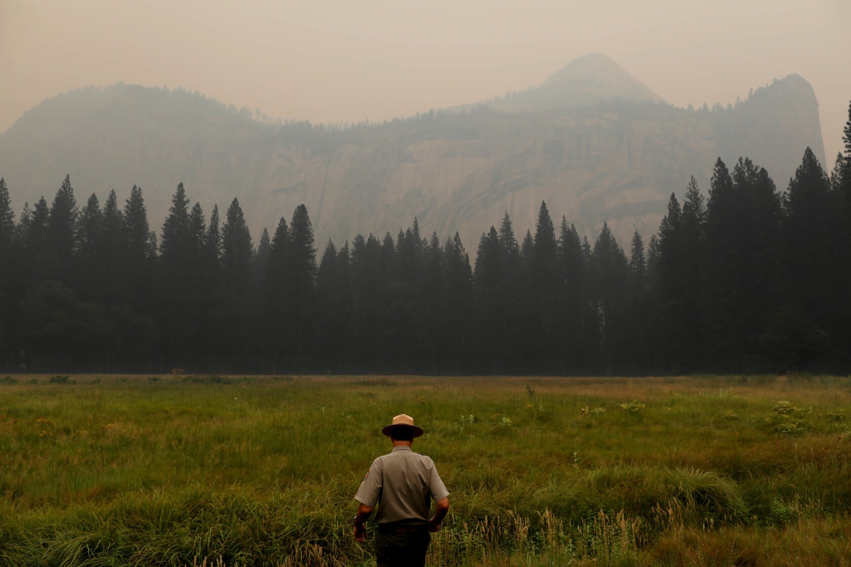 Fire siege leaves Yosemite empty of humans, filled with