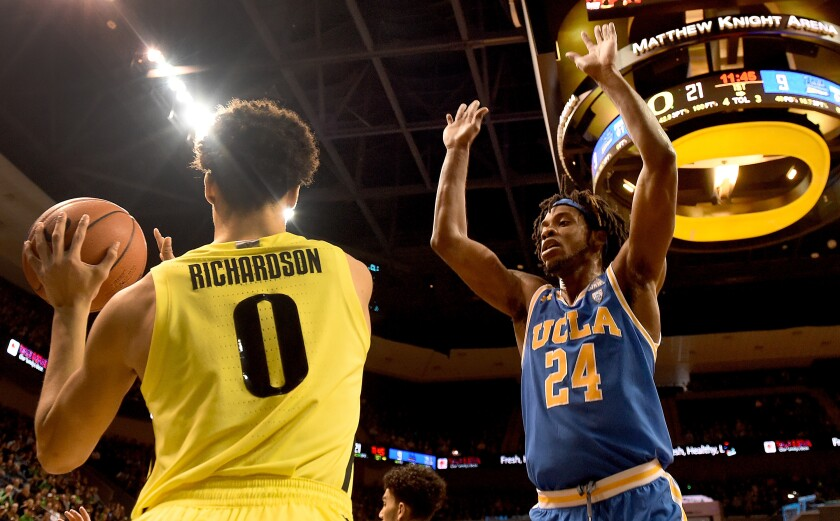 UCLA's Jalen Hill, right, tries to stop Oregon's Will Richardson from making an inbound pass during a game on Jan. 26.