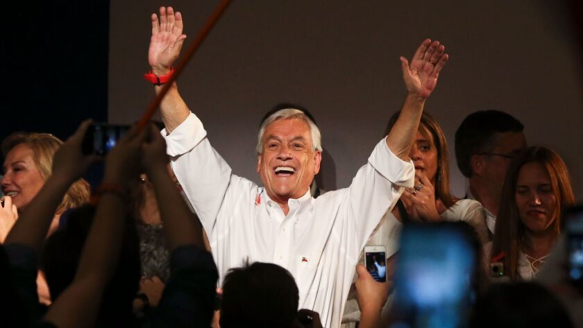 Former Chilean President Sebastian Piñera celebrates the first official results showing him leading Chile's presidential election on Sunday.