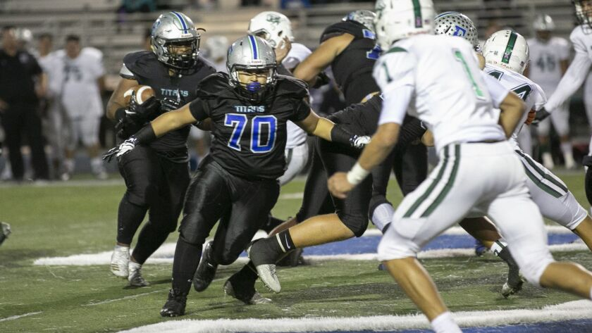 Eastlake's Sebastian Sanchez (70) blocks for running back Roman Coe in the Titans' win over Oceanside.