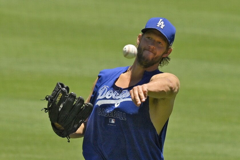 Dodgers pitcher Clayton Kershaw warms up July 4, 2020, during summer training camp.