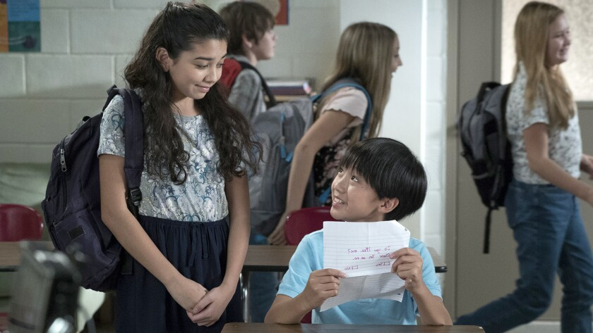 """Evan (Ian Chen) has a girlfriend (Julia Garcia) in a new episode of """"Fresh Off the Boat"""" on ABC."""