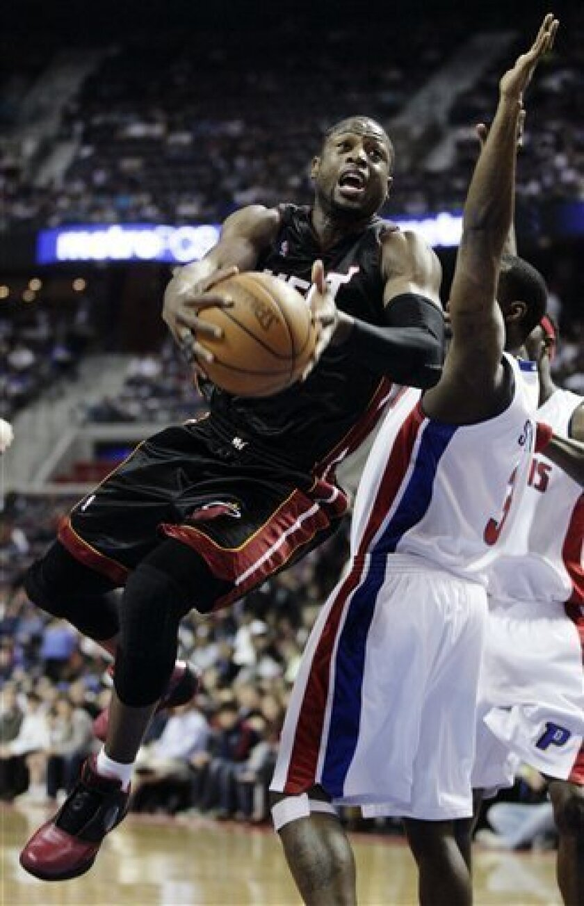 FILE - In this March 31, 2010, file photo, Miami Heat guard Dwyane Wade, left, goes to the basket past Detroit Pistons guard Rodney Stuckey in the first half of an NBA basketball game in Auburn Hills, Mich. (AP Photo/Duane Burleson, File0