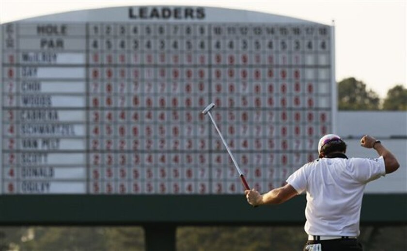Rory McIlroy of Northern Ireland reacts after making a birdie on the 17th hole during the third round of the Masters golf tournament Saturday, April 9, 2011, in Augusta, Ga. (AP Photo/David J. Phillip)