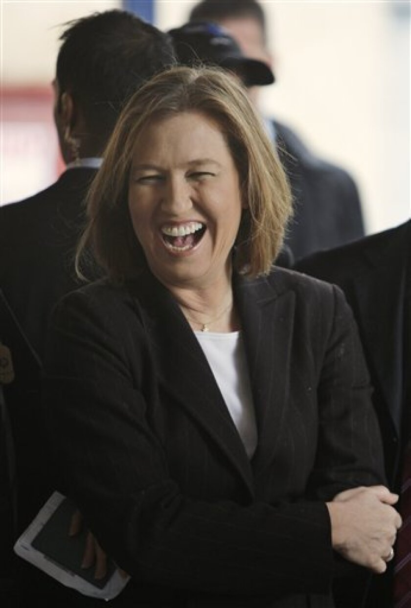 Israeli Foreign Minister and Kadima party candidate Tzipi Livni smiles as she waits for her turn to vote at a polling station in Tel Aviv, Israel, Tuesday, Feb. 10, 2009. The two front-runners in the race to rule Israel, Livni and Israel's Likud Party leader Benjamin Netanyahu, made last-minute appeals to voters as polls opened Tuesday in a close general election whose outcome could determine the course of Mideast peace negotiations. (AP Photo/Ariel Schalit)