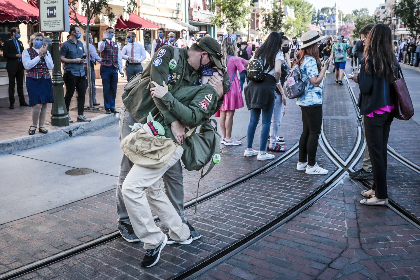 ANAHEIM CA APRIL 30, 2021 - A couple recreate the famous Alfred Eisenstaedt V-J Day photo inside Disneyland as the theme park reopens for the first time in more than a year on Friday, April 30, 2021. The reopening of Disneyland, which was shut down in March of last year due to the COVID-19 pandemic. ``is a monumental day for Anaheim,'' city spokesman Mike Lyster said.(Robert Gauthier / Los Angeles Times)