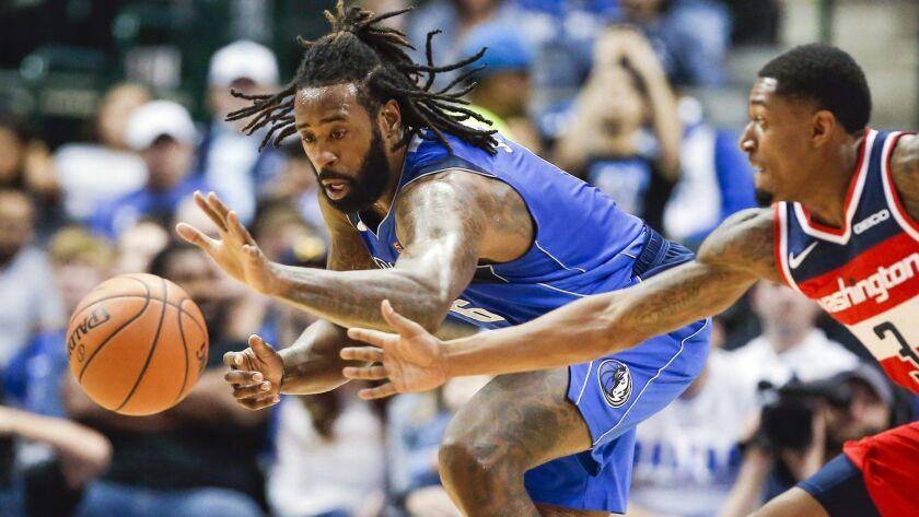 Dallas Mavericks forward DeAndre Jordan, left, and Washington Wizards guard Bradley Beal (3) chase a