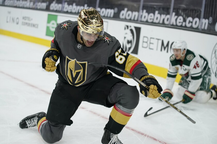 Vegas Golden Knights left wing Max Pacioretty (67) celebrates after scoring against the Minnesota Wild during overtime of an NHL hockey game Monday, March 1, 2021, in Las Vegas. (AP Photo/John Locher)