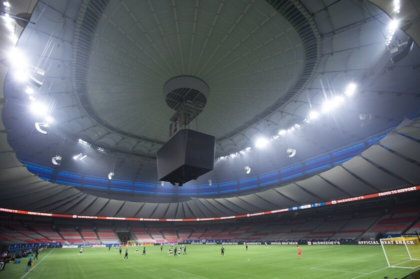 The Vancouver Whitecaps play the Montreal Impact during the second half of an MLS soccer match, in an empty B.C. Place due to COVID-19 protocols, Wednesday, Sept. 16, 2020, in Vancouver, British Columbia. (Jonathan Hayward/The Canadian Press via AP)