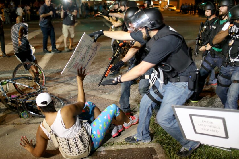 Police confront protesters in Ferguson, Mo., in the days after the August 2014 shooting death of Michael Brown.