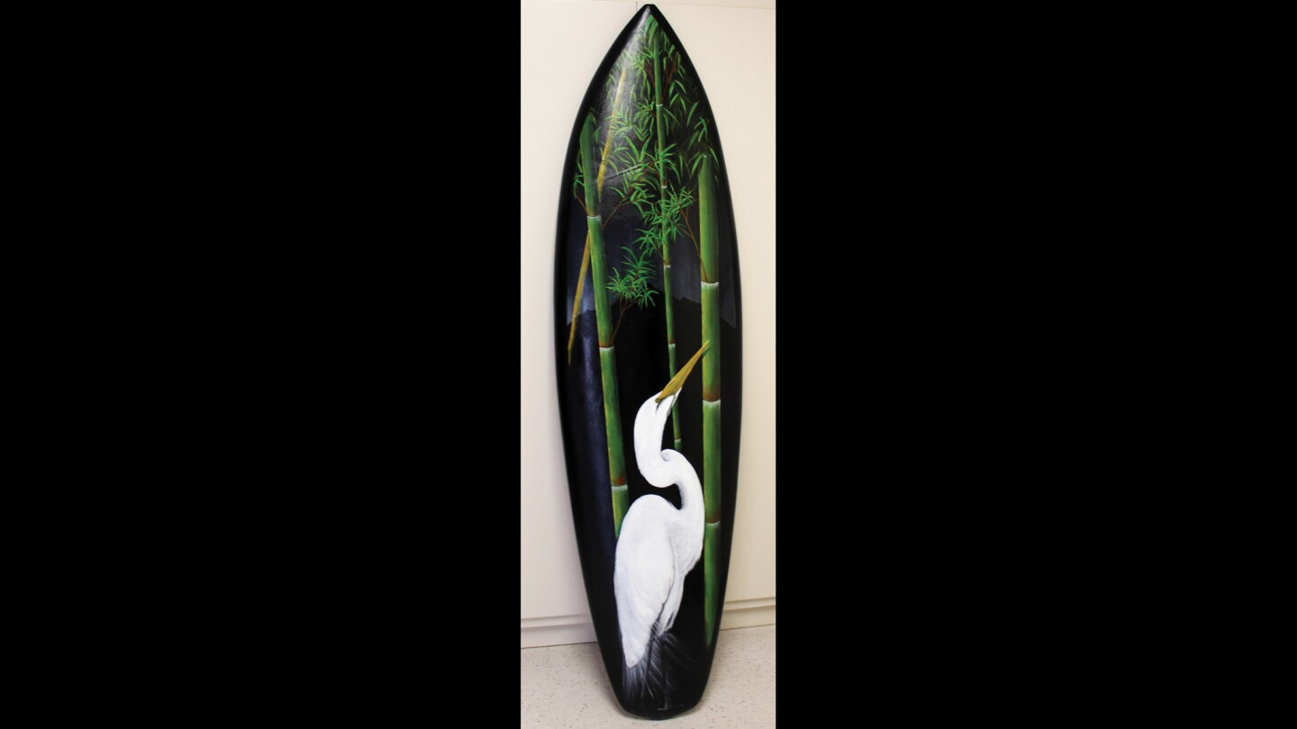 """The Surfboard Art Festival artworks will be on display through Nov. 28 in Morro Bay. This artwork is titled """"Egret"""" by Wayne Velte."""