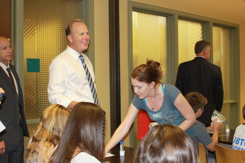San Diego Mayor Kevin Faulconer literally rolled up his sleeves to observe a biotech workshop taking place at La Jolla's Riford Library Sept. 1.