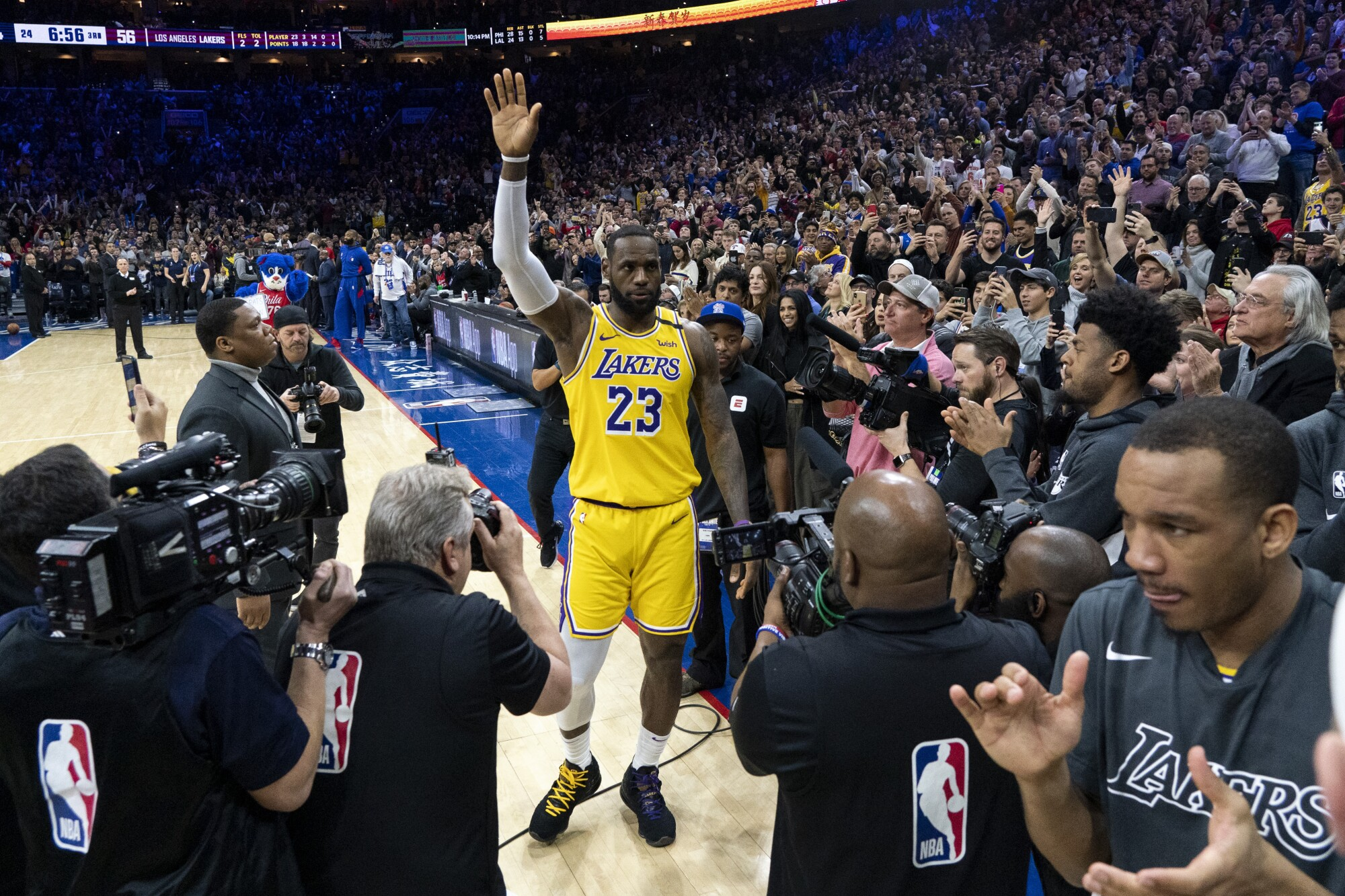 Lakers forward LeBron James acknowledges the fans' ovation after passing Kobe Bryant for No. 3 on the all-time scoring list.