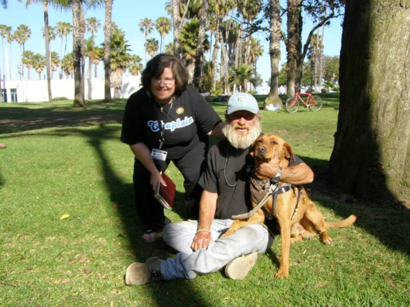 Hobo and Dreamer in the park with chaplain Kathy Davis.