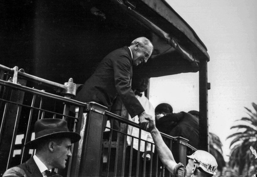 President Woodrow Wilson shakes hands at the Santa Fe station in Los Angeles.