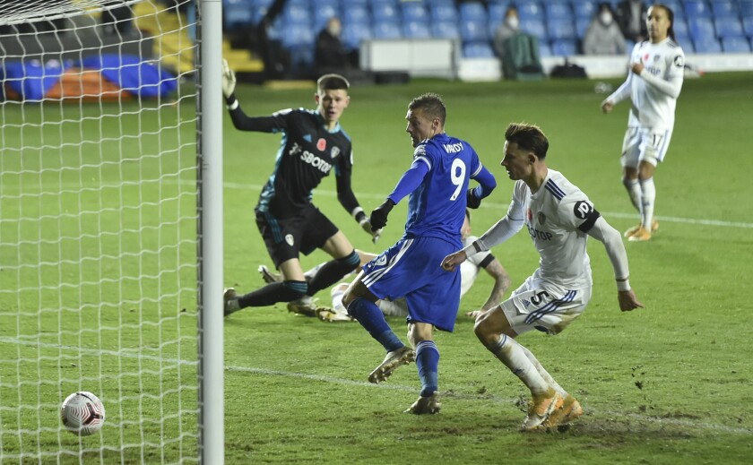 Leicester's Jamie Vardy center, scores his sides third goal of the game during the English Premier League soccer match between Leeds United and Leicester City at Elland Road in Leeds, England, Monday, Nov. 2, 2020. (Peter Powell/Pool via AP)