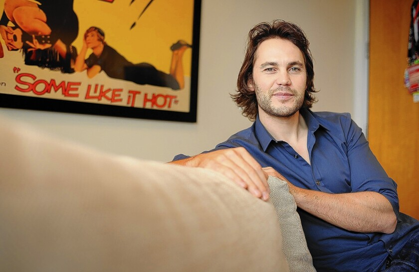 """Actor Taylor Kitsch plays a young doctor recruited by a small coastal town in the movie """"The Grand Seduction."""""""