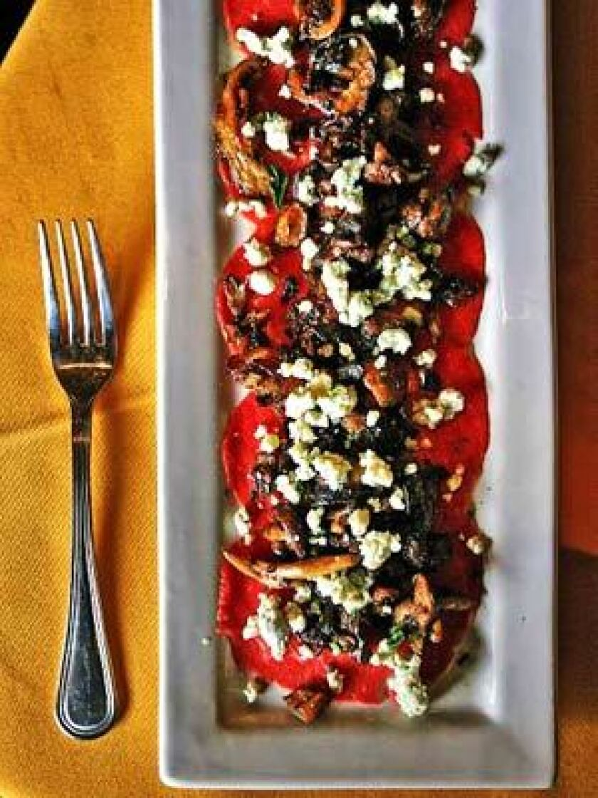 Beef carpaccio with roasted wild mushrooms, blue cheese, extra virgin olive oil and fresh pepper is served at Firenze Osteria in Toluca Lake.