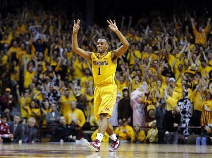 Minnesota's Andre Hollins (1) celebrates after hitting a 3-pointer against Wisconsin during overtime in an NCAA college basketball game, Thursday, Feb. 14, 2013, in Minneapolis. Hollins finished with 21 points and Minnesota won 58-53. (AP Photo/Genevieve Ross)