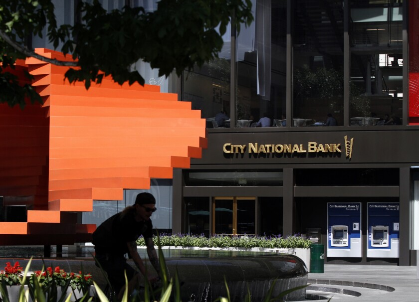 A judge has ruled that downtown L.A.'s City National Bank overcharged its employees' 401(k) retirement plan between 2006 and 2012. The bank plans to fight the ruling.