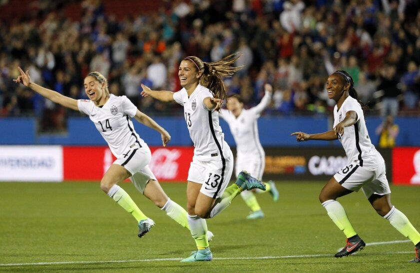 Unites States' Alex Morgan (13), Morgan Brian (14) and Crystal Dunn, right, celebrate a goal by Morgan against Costa Rica during the first half of a CONCACAF Olympic qualifying tournament soccer match Wednesday, Feb. 10, 2016, in Frisco, Texas. (AP Photo/Tony Gutierrez)