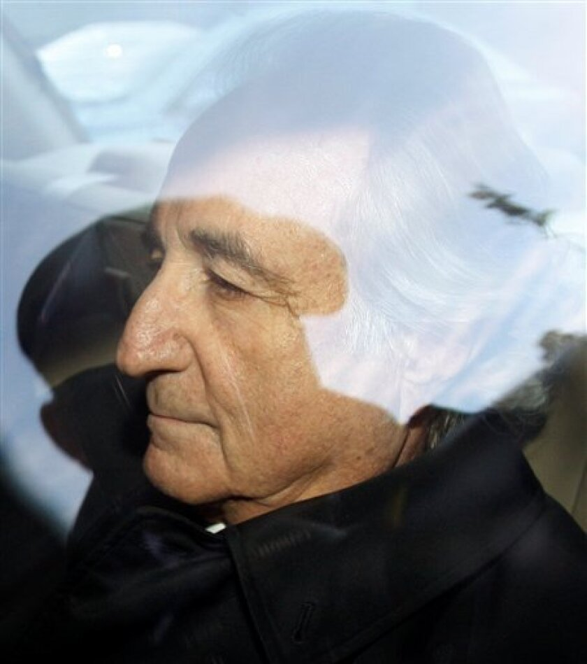 In this Jan. 5, 2009 file photo, disgraced financier Bernard Madoff leaves U.S. District Court in Manhattan after a bail hearing in New York. (AP Photo/Kathy Willens, File)