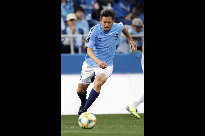 In this Nov. 24, 2019, photo, Yokohama FC's Kazuyoshi Miura controls the ball during J-2 league soccer match against Ehime FC in Yokohama, near Tokyo. One of the longest careers in soccer has been extended after 52-year-old striker Miura signed a contract with J-League club Yokohama FC on Saturday, Jan. 11, 2020. Miura, who will turn 53 on Feb. 26, will enter his 35th season this year. (Kyodo News via AP)