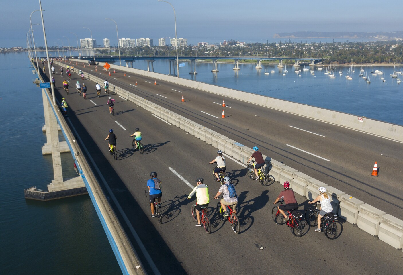 Bicyclists ride over the San Diego-Coronado Bridge during the 12th Annual Bike the Bay, a non-competitive community 25-mile bike ride through the five cities surrounding San Diego Bay via the Bayshore Bikeway on Sunday, August 25, 2019.