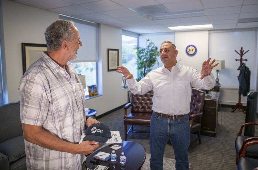 George Sams of Placentia talks with Rep. Gil Cisneros.