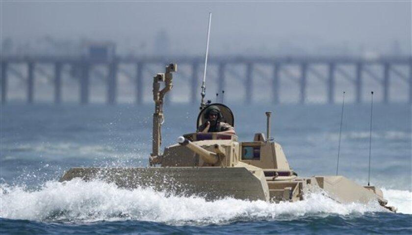 Defense Secretary Robert Gates said Thursday he would cancel a $13 billion plan to buy the Marines amphibious assault vehicles from General Dynamics.