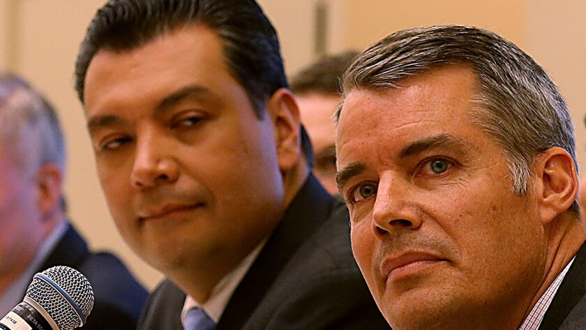 Alex Padilla, left, and Pete Peterson are shown in downtown Los Angeles in March. Both are running for the position of California secretary of state.
