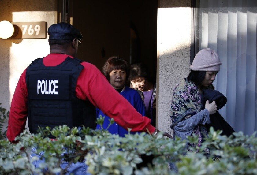 "Federal agents serve warrants and question several residents at an apartment complex in Rowland Heights as part of an investigation into Southland-based ""maternity tourism"" schemes."