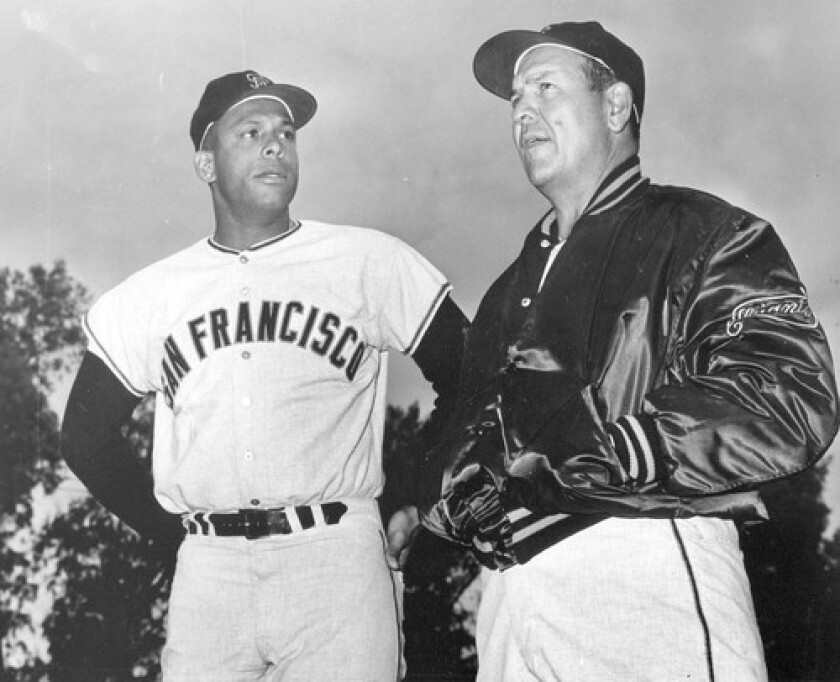 Herman Franks, right, replaced Alvin Dark as manager of the San Francisco Giants after the 1964 season. Looking on is first baseman Orlando Cepeda. Franks led the team to four consecutive second-place finishes from 1965 to 1969.