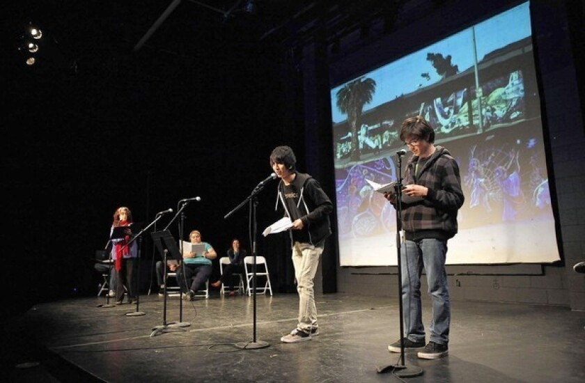 Monterey Continuation High School students Christopher Lizarraras, center, and Jose Herrera, right, participate in a play about the East Los Streetscapers -- muralists Wayne Healy and David Botello -- during a performance at the Plaza de la Raza's Margo Albert Theater.
